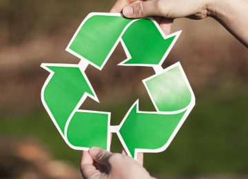recycle-background-with-woman-holding-recycle-sign